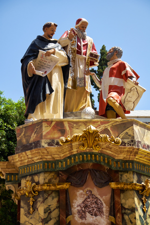 VALLETTA, MALTA - JULY 31, 2015: A holiday decoration presents the scene from the life of the saints.  The statues made of papier-mache are prepared for the holiday of Assumption of Virgin Mary.