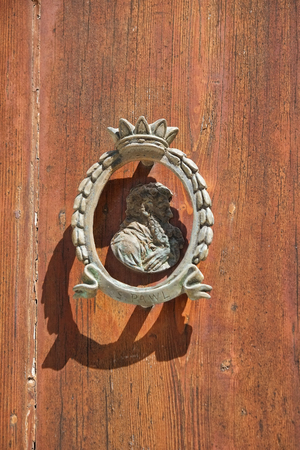 pawl: An Old style door decoration in the shape of St. Pauls head. Rabat. Malta Stock Photo