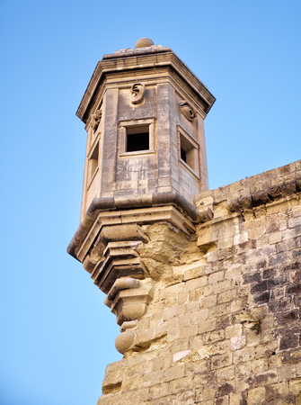 The Guard tower on the end of Senglea (L-isla) peninsula bastion with sculpted symbols  (eye, ear and nose) representing guardianship and observance protecting the Maltese shores. Senglea, Malta.