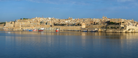 enceinte: The panoramic view of Valletta capital city over the water of Grand harbor from the Kalkara penincula. Malta Stock Photo