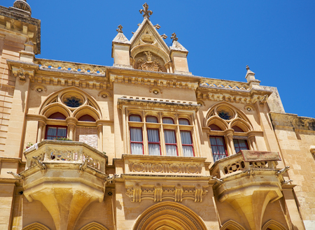 The Baroque style facade of the austere Bishops Palace on the Pjazza San Pawl in Mdina. Malta