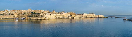 The panoramic view of Valletta capital city over the water of Grand harbor from the Kalkara penincula. Malta Stock Photo