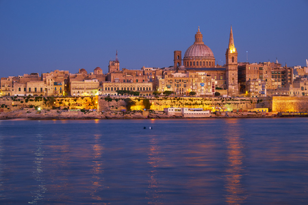 The Valletta skyline with Basilica of Our Lady of Mount Carmel as seen from Sliema in the evening light. Malta Editorial