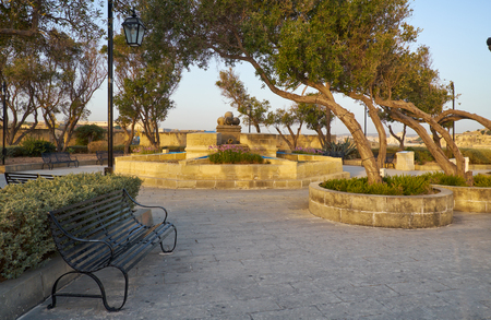 The early morning view of Gardjola Gardens with fountain in the center in the shape of the Maltese cross, Senglea, Malta Stock Photo