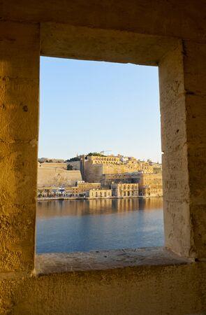 The view of Valletta Fort Lascaris from the window of Guard tower on the end of Senglea (L-isla) peninsula bastion. Senglea, Malta