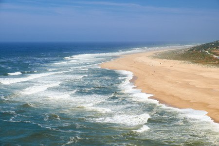 View on Nazare atlantic coast and sandy beach in Portugal Stock Photo