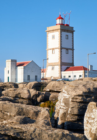 Lighthouse of cape Carvoeiro (Cape of Coal) with rocks on foreground, Peniche peninsula, Portugal Banco de Imagens