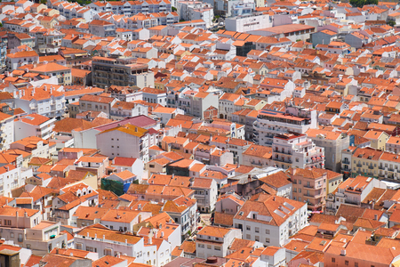 Birds-eye view on buildings red tiled roofs of Nazare town in Portugal