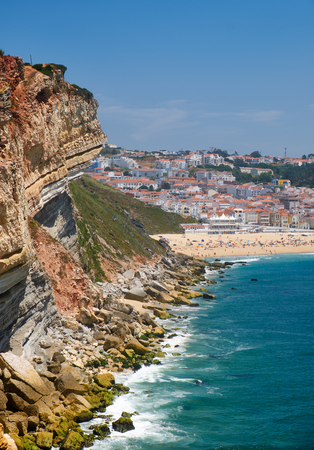 Rocks between Farol De Nazare and Nazare beach and town. Portugal Banco de Imagens