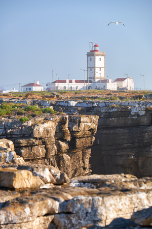 Lighthouse of cape Carvoeiro (Cape of Coal) with rocks on foreground, Peniche peninsula, Portugal Imagens