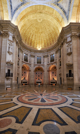 LISBON, PORTUGAL - JUNE 25, 2016: Interior of National Pantheon (Santa Engracia church). View of floor decorated with polychromed patterns of marble and apse with three cenotaphs. Lisbon. Portugal Editorial
