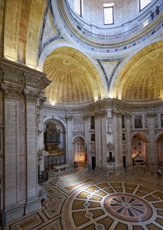 LISBON, PORTUGAL - JUNE 25, 2016: The interior of National Pantheon (former Church of Santa Engracia) with pipe baroque organ in altar apse and cenotaphs in the right apse. Lisbon. Portugal Editorial