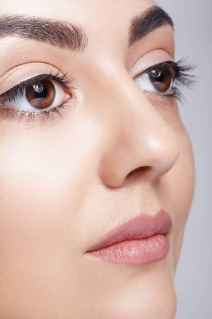 Closeup shot of female face with day makeup eyes shadows