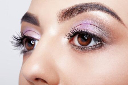 Closeup shot of female eye with day makeup eyes shadows Stock Photo