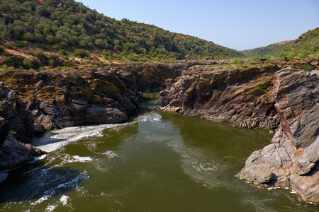 Pulo do Lobo or wolfs leap waterfall and cascade on river Guadiana in vicinity of Mertola, Alentejo, Portugal Stock Photo