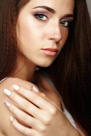 nighty: Closeup beauty portrait of young woman. Brunette girl with long hair and day female makeup. Stock Photo