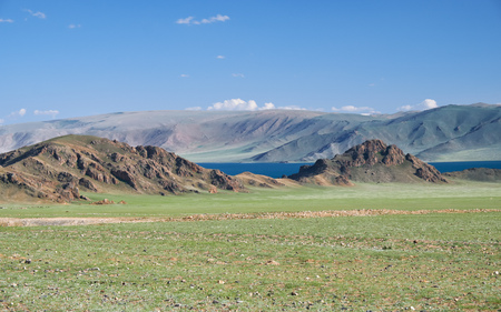 Mongolian natural landscapes near lake Tolbo-Nuur surrounded by mountains and rocks  in north Mongolia. Stock Photo
