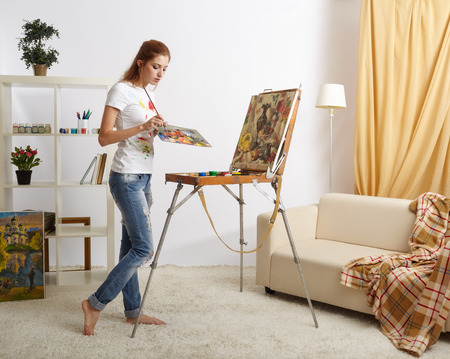 Painter woman with wooden sketchbook and painting Stock Photo