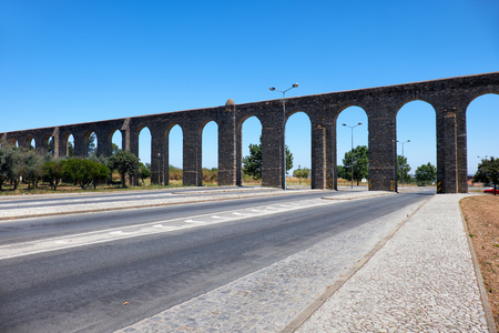 rebuilt: The stone aqueduct of Silver Water (Prata Aqueduct)  outside the walls of Evora. Evora aqueduct is  the rebuilt old Roman aqueduct bringing clear water to the city center. Evora. Portugal Stock Photo