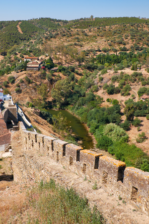 The defensive wall with battlements which encloses an area of the old town  Mertola. Baixo Alentejo. Portugal Stock Photo