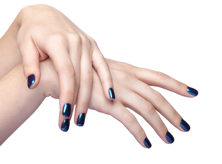 Female fingers with shiny blue nails manicure. Girls hands isolated on white background Stock Photo