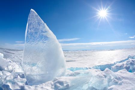 baical: Ice floe and sun over winter Baikal lake Stock Photo