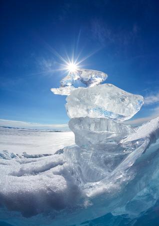 baical: Ice floe crystals and sun over winter Baikal lake Stock Photo