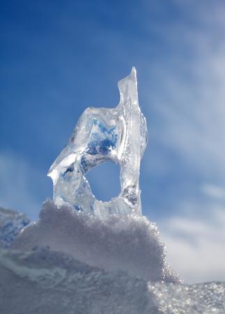 baical: Ice floe crystal under blue sky over winter Baikal lake
