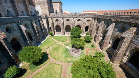 A cloister running along the walls of Cathedral (Se) of Evora and forming a quadrangle of interior courtyard. Evora. Portugal.