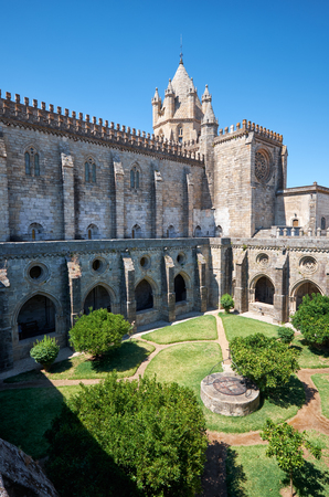 The view of the Cathedral (Se) of Evora with the cloister circumjacent the interior courtyard. Evora. Portugal. Stock Photo