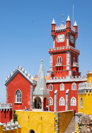 SINTRA, PORTUGAL - JULY 03, 2016: The view of Clock tower and chapel of the original Monastery of the Hieronymite monks. Pena Palace. Sintra. Portugal