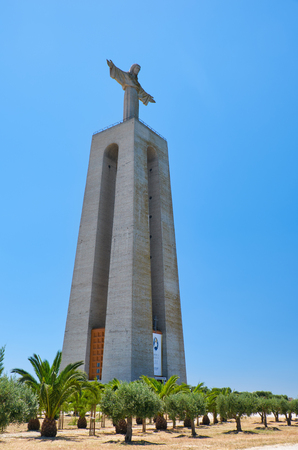 world war ii: LISBON, PORTUGAL - JULY 02, 2016: Sanctuary of Christ the King overlooking the Lisbon. Catholic monument erected as a plea to God to release Portugal from entering World War II. Lisbon. Portugal