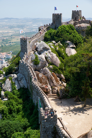 SINTRA, PORTUGAL - JULY 03, 2016:  The long curtain north walls with parapets and the Keep towers provide the defenders with the safe view over surrounding land. Moorish Castle. Sintra. Portugal