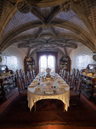 ceiling plate: SINTRA, PORTUGAL - JULY 03, 2016: The interior of the Pena Palace. The royal dining room with the table served for the guests arrival. Pena Palace. Sintra. Portugal