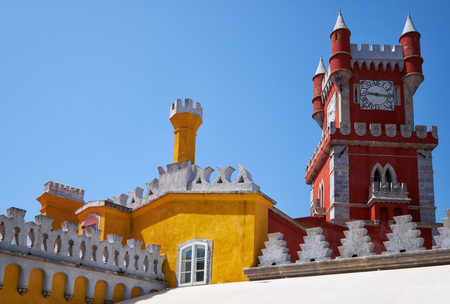The view of Clock tower and the curtain walls with decorative battlements. Pena Palace. Sintra. Portugal Editorial