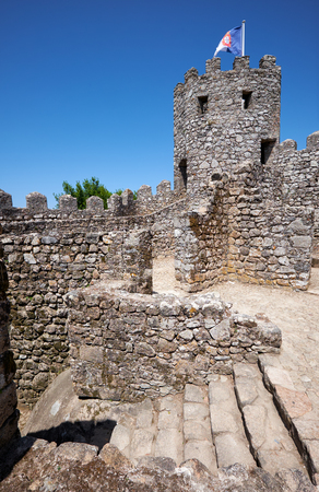 Parapets on the top of curtain walls and solid tower provides the defenders with the safe view over surrounding land. Castle of the Moors. Sintra. Portugal Editorial