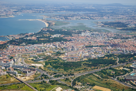 The air view of Almada on the left bank of Tagus river. Lisbon. Portugal