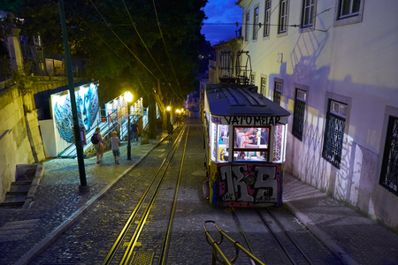 LISBON, PORTUGAL - JUNE 24, 2016: Funicular of Gloria (Elevador da Gloria) goes up the Gloria street in the night light. Lisbon. Portugal