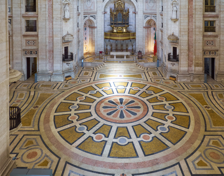 LISBON, PORTUGAL - JUNE 25, 2016: The view along the central nave of Santa Engracia Church (National Pantheon) on the pipe baroque organ and floor decorated with polychromed marble. Lisbon. Portugal