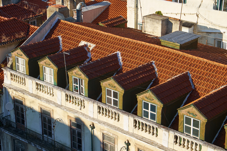 Mansard rooftops with dormer windows in Pombaline Lower Town as seen from the observation platform of Santa Justa Lift. Lisbon. Portugal