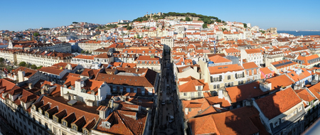 Panorama of  Alfama with Saint George Castle on the hilltop on the background as seen from the observation platform of Santa Justa Lift. Lisbon. Portugal