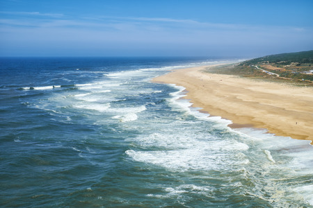 View on Nazare atlantic coast and sandy beach in Portugal Фото со стока