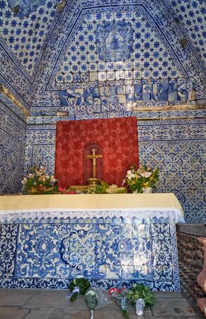NAZARE, PORTUGAL - JUNE 26, 2016: The interior of the Memory Chapel (Ermida da Memoria) covered with azulejo tiles. The church was built to commemorate the Legend of Nazare. Nazare. Portugal