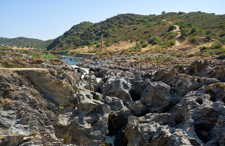 Pulo do Lobo (Wolf's leap) waterfall is a cascades of river Guadiana which water finds its way through limestone rocks, Guadiana river valley Natural park, Alentejo, Portugal Foto de archivo - 93139892