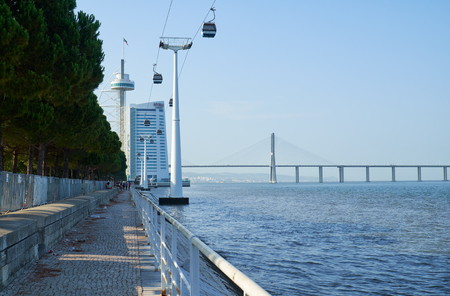 LISBON, PORTUGAL - JULY 04, 2016: The view of cable car way to the Torre Vasco da Gama over water of the Tagus river. Lisbon. Portugal