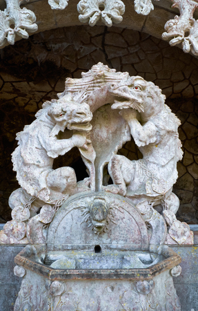 The fountain statues of the dragons at the portal of the Guardians - the entrance way to the Initiatic well in Quinta da Regaleira estate. Sintra. Portugal 写真素材