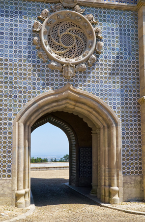 The Neo-Manueline style window in the fashion of a Rosaceae over the arched passageway on the western facade of the New Palace. Palace of Pena. Sintra. Portugal