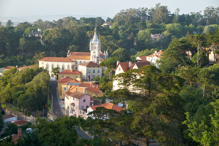 The view of Sintra town with fairy building of City Hall building  (Camara Municipal de Sintra) in neo-manueline style among the thick green shade of trees. Portugal