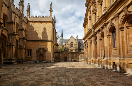 The view of the old yard of the Oxford University surrounded by Divinity School,  Chancellor's court, Bodleian Library and Sheldonian Theater. Oxford. England