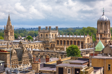 The view of main Christ Church college buildings: Cathedral, Tom Tower, Tom Quad, Great Dining Hall and Bodley Tower from the top of Carfax Tower. Oxford University. England Editorial